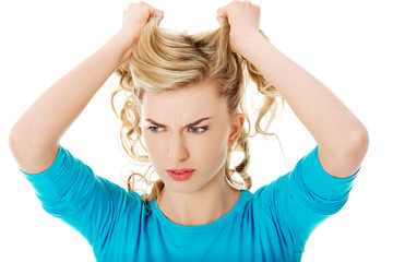 Portrait of angry woman pulling her hair