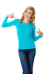 Smiling woman pointing at her shirt
