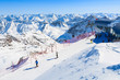Skiers on slope in mountain winter resort of Pitztal, Austria