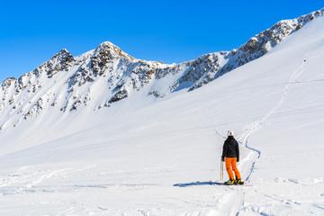 Skier in winter mountain resort of Pitztal, Austrian Alps