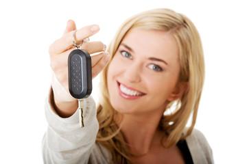 Portrait of happy woman holding a car key