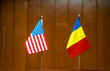 American and romanian table flags