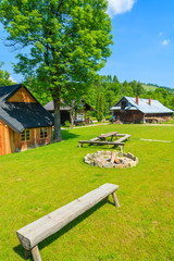 Wooden mountain houses on green field in summer, Pieniny, Poland