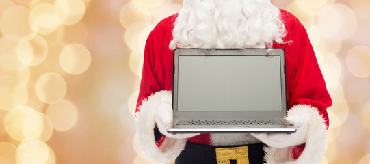 close up of santa claus with laptop