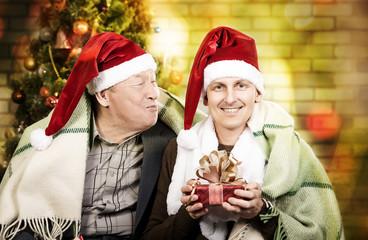 Two men in Santa hats ChristmasTwo men in Santa hats Christmas