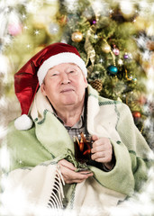 elderly man drinking hot mulled wine. elderly man drinking hot m
