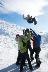 group of hikers faving fun in winter mountains
