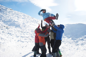 group of hikers have fun in winter mountains
