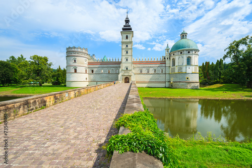 Entrance over a bridge to Krasiczyn castle in summer, Poland - 73549461
