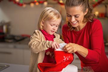 Portrait of happy mother and baby with christmas stocking