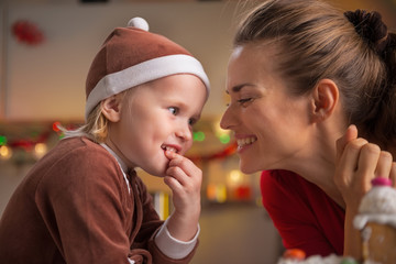 Portrait of happy mother and baby in christmas costume