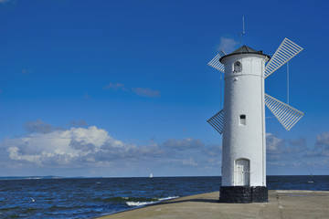 Lighthouse - windmill against the sky - Swinoujscie