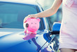 woman customer, agent and new car, pink piggy bank key on hood - 73551087