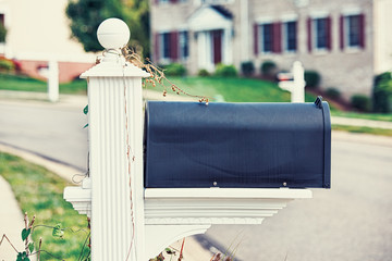 Mail Box on a house background