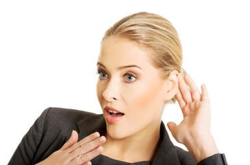 Woman overhearing a conversation