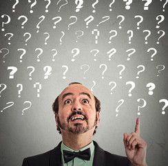 man pointing up has idea solution answer to many questions