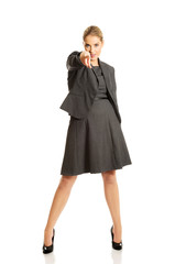 Businesswoman pointing at you