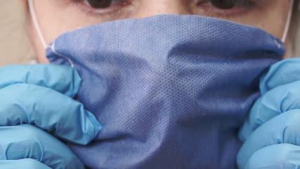 Nurse Puts On Medical Mask