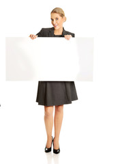 Businesswoman holding empty billboard