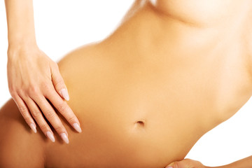 Close up on a perfect slim woman belly