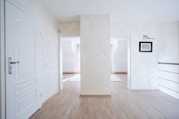 Spacious hall with white doors