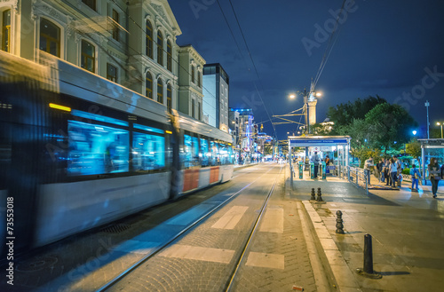 Istanbul train arriving in Sultanahmet Square at night - 73553018