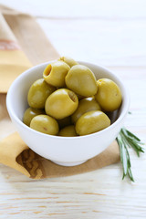 olives in bowl on white table