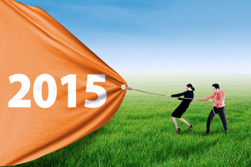 Business people pulling number of 2015