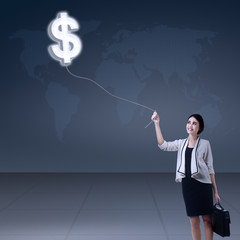Businesswoman with symbol currency of dollar