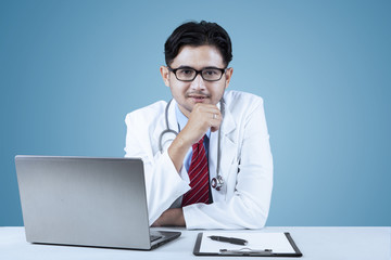 Confident doctor looking at camera