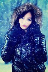 Elegant girl in winter jacket