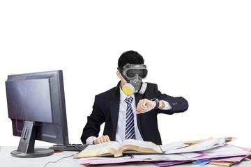 Employee wearing gas mask in workplace