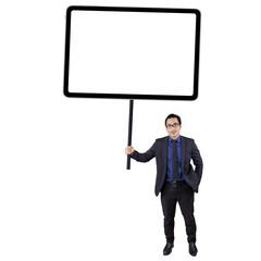 Entrepreneur holds blank signboard