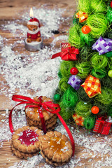 fragrant cookies on background of decorated Christmas ornaments