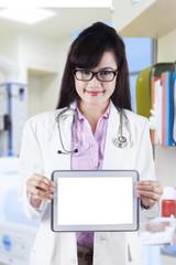 Female practitioner showing digital tablet 1