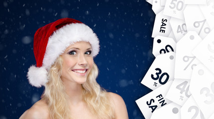 Woman in Christmas offer big discount on gifts, snow background