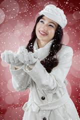 Happy girl catch snowfall