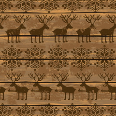 Christmas seamless pattern with deers and snowflakes