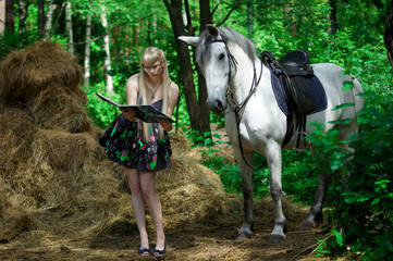 Girl and horse walking in the woods