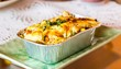 Lasagne ready meal in foil container. - 73557861