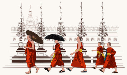 Buddhist monks walking in a temple
