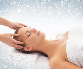 Woman getting massage treatment on a snowy background