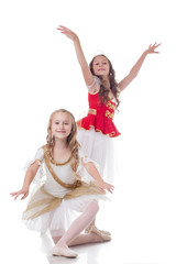Smiling young ballerinas, isolated on white