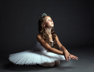 Image of pensive young ballerina dancing in studio