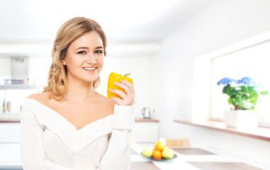 Young and beautiful girl drinking fresh orange juice