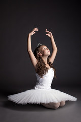 Studio shot of dreamy graceful ballerina