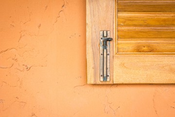 vintage window latch on a classic timber window panel