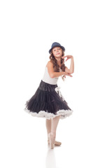 Funny young ballerina posing at camera