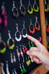 Woman choosing earrings in a shop