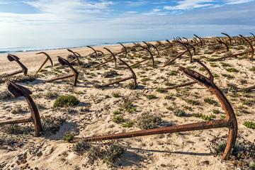 Cemetery of anchors on the beach at Praia Do Barril in Santa Luz